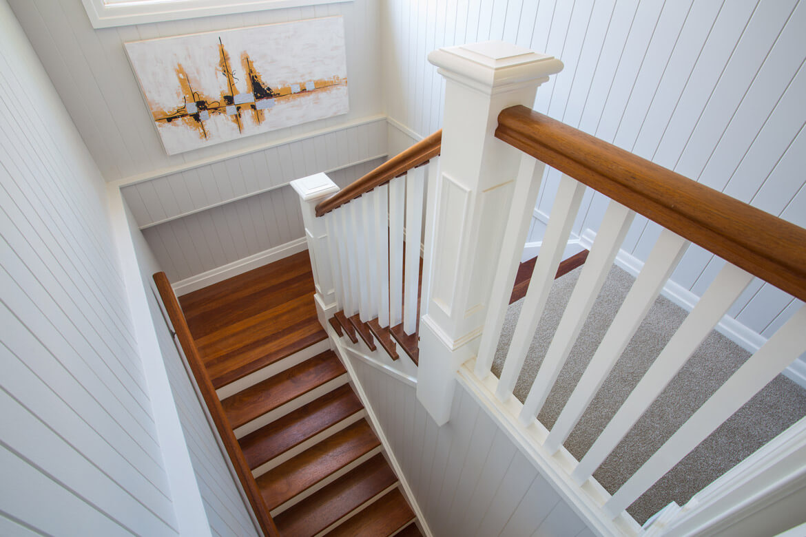 Timber stairway with tongue and groove walls.